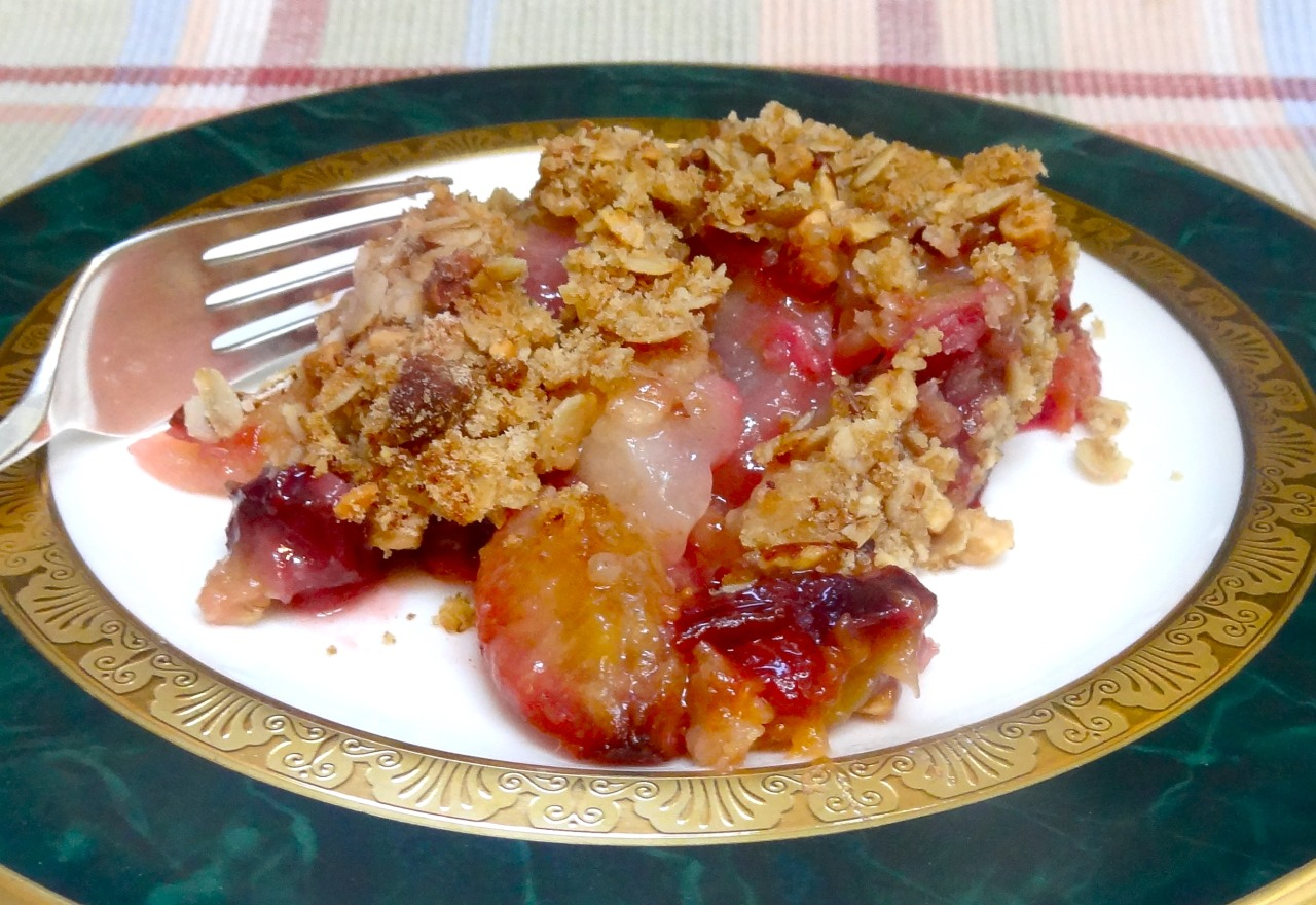 Something old, something new.  No, not a wedding item. Just a plain old dessert. Plum and Pear Crisp. Because I wanted to use the last of the late summer season's prune-plums and the first of autumn's new pears. I just happened to have some of both on hand. Such a homey, comforting way to transition from one season to the next.     Plum and Pear Crisp Crisp top 2 ripe pears (Bartlett, Comice or Anjou) 10-12 prune plums 1/3 cup raisins 1/3 cup sugar 2 tablespoons all-purpose flour 1/4 teaspoon ground cinnamon 1 tablespoon lemon juice Preheat the oven to 350 degrees. Prepare the Crisp top and set it aside. Peel, core and deseed the pears and cut them into chunks. Place them in a bowl. Cut the plums in half, remove the pit and cut the halves again into halves. Add to the pears. Add the raisins, sugar, flour, cinnamon and lemon juice. Toss the ingredients and place in a baking dish. Cover with the Crisp top and bake for 30-35 minutes or until the top is crispy and browned. Makes 6 servings Crisp top 1/2 cup old fashioned oats