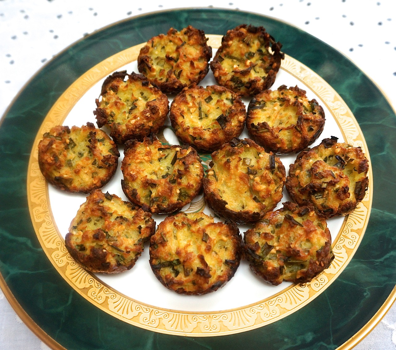 Need a quick nosh during Passover?   These crispy potato bites do the trick. I haven't met anyone who doesn't like them. In fact they remind me of franks-in-blankets, the kind of tidbit people don't want to admit they love, but they actually love them so much they eat more of them than they would ever guess.    I make these potato bites ahead and reheat them when needed (defrosted, 400 degree preheated oven for about 8-10 minutes) — although I have seen members of my clan eat them cold, saving me the trouble of washing a baking sheet.     They're not just for Passover, btw. I serve them for sports events (like Superbowl) and other times that I've got a small crowd coming over.                         Crispy Potato Bites           12 ounces Yukon Gold potatoes, peeled and cut into chunks      1/4 cup chopped fresh chives     1 tablespoon chopped fresh rosemary     1 large egg     2 tablespoons vegetable oil     2 tablespoons matzo meal     1/2 teaspoon Passover baking powder     salt and freshly ground black pepper to taste           Preheat oven to 400 degrees. Lightly grease 16-18 mini muffin tin cups (or use cooking spray). Shred the potatoes in a food processor, scoop the shreds, replace the shredding disk with the S-blade and return the shredded potatoes to the workbowl. Chop the potatoes until they are small pieces. Squeeze excess liquid out of the potatoes. Place the potatoes in a bowl. Add the chives, rosemary, egg, vegetable oil, matzo meal, baking powder and salt and pepper to taste. Mix the ingredients thoroughly to blend them completely. Spoon equal amounts of the potato mixture into the mini muffin cups. Bake for 25-30 minutes or until crispy and golden brown.             Makes 16-18