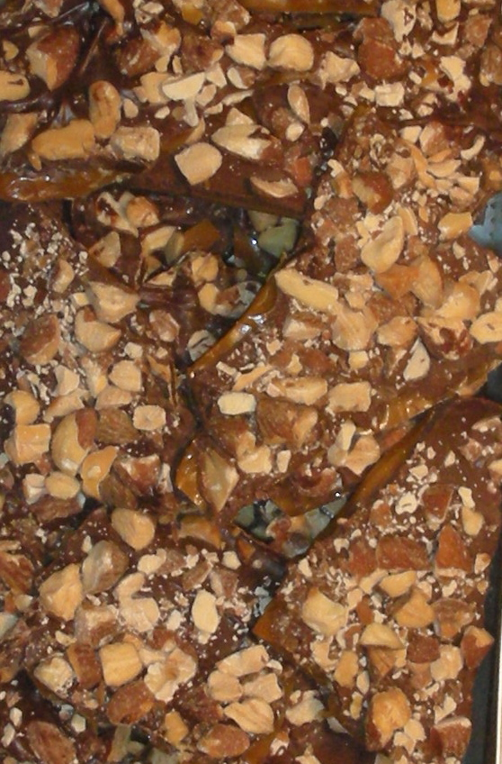 "If the world is going to end tomorrow, I want Buttercrunch.     Whoever invented it knew all about combining sweet and salty together in a candy long before the modern love for  caramels with sea salt  .      We didn't talk about the sweet and salt back in the Buttercrunch day. We just ate it like there was no tomorrow.     So again, if there isn't going to be one (a tomorrow I mean), I want to bite into a piece or eight of this; every bite with a   brittle, salty crunch and creamy, soft, sweet chocolate melting around it and that final flourish of tender, toasty almonds.     Butter Crunch    1 cup butter   3/4 cup sugar   1/4 teaspoon salt   2 tablespoons light corn syrup   2 tablespoons water   9 ounces semisweet chocolate, chopped (1-1/2 cups chocolate chips)   3/4 cup chopped lightly toasted almonds   Lightly butter a 9""x13"" sheet cake pan. Place the butter, sugar, salt, corn syrup and water into a deep saucepan. Cook over medium heat, stirring constantly with a wooden spoon until the mixture starts to bubble. Continue to cook, stirring occasionally, until the mixture is golden brown (about 7-8 minutes) or until a candy thermometer reads 280 degrees. Pour the mixture into the prepared pan and spread it out evenly. Immediately sprinkle the chocolate on top. Let it melt briefly, then use a spatula or the back of a large spoon to spread the chocolate evenly over the candy. Keep spreading until the chocolate is completely melted and smooth. Sprinkle the nuts on top and press them in lightly. Let cool until the chocolate is firm and set, about 2 hours. Break into pieces. Makes about 1-1/4 pounds, enough for one person, or two if you want to share   :)"
