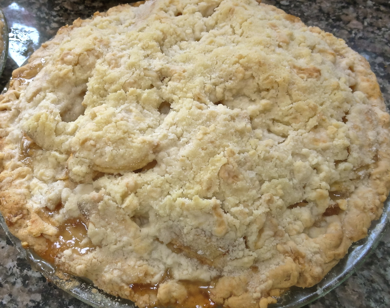 Is there a homier, more comforting, more luscious summer dessert than peach pie? Here's an easy, easy version, straight from my Mom's hand-written recipe.     She baked her pies with the peaches that grew in our backyard. Alas, I can barely get a chili pepper to grow, so I rely on stores and farmer's markets.    Mmmmm. There were good peaches at the local Farmer's Market a few days ago.    Ate some. Poached some. Grilled some.    The rest? You can see it here.    Peach pie. Just like Mom's, although I used white peaches this time and she usually used yellow. No difference really. I just bought the ones that looked good and smelled fragrant.      Peach Pie    8 large, ripe peaches, peeled and cut into slices  3 tablespoons lemon juice  1/2 cup sugar  3 tablespoons minute tapioca  dash of salt  1/2 teaspoon cinnamon  1 unbaked 9-inch pie crust     streusel crust:    3/4 cup flour  1/3 cup sugar  1/2 teaspoon cinnamon  dash of salt  6 tablespoons cold butter, cut into small pieces    Preheat the oven to 375 degrees. Place peaches in a large bowl. Toss the peaches with the lemon juice. Add the sugar, tapioca, salt and cinnamon and toss ingredients to coat the peach slices. Pour the mixture into the unbaked pie crust.     To make the streusel: in another bowl, or in an electric mixer or food processor, combine the flour, sugar, cinnamon and dash of salt. Add the butter and work the pieces into the dry ingredients with hands or a pastry blender (or on low with a flat beater in a mixer, or on pulse with a food processor) until the mixture resembles coarse meal. Place the crumbs on top of the peach filling. Bake for about 45 minutes or until top is golden brown.  Makes one 9-inch pie
