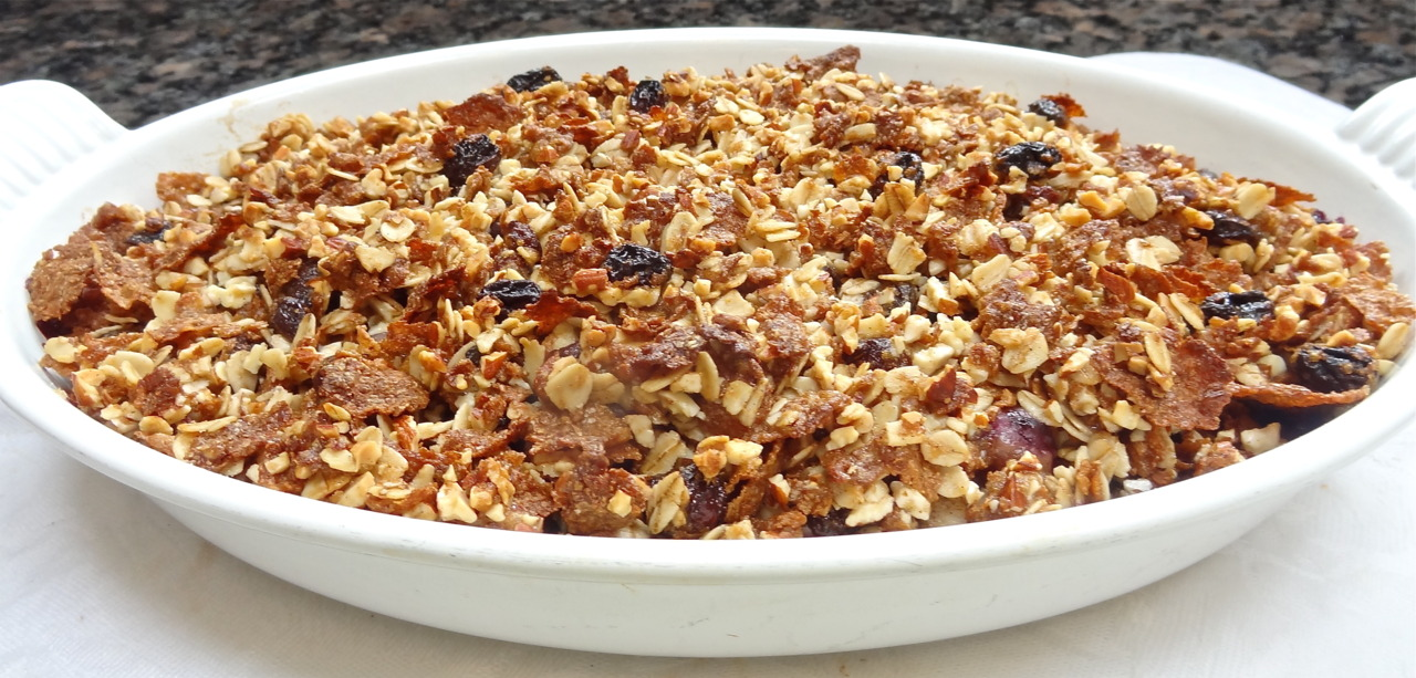 What's one of the best things you can do with boxed breakfast cereal? Use it as crust for fruit crisps!  My Mom used cereal crust over apples and when I went to visit my parents on cool autumn days the perfume of this dish baking in the oven would reach me all the way out past the garage. As soon as I opened the car door I'd know I was in for a really good treat for dessert.   She served the dish still warm, with cold cream on top.  Those were good days.  When I wrote my last cookbook,  Hip Kosher , I decided to include My Mom's special recipe but use it with blueberries, not apples. And this week, when I saw some good looking blueberries on sale, I decided to make that dish for my weekend company. I used Raisin Bran, rolled oats and almonds.  This was a big hit.   Btw, for variety, you can make a simple change by adding some sliced peaches.      BLUEBERRY CRISP        2 pints fresh blueberries  1/3 cup sugar  5 tablespoons all-purpose flour  1/4 teaspoon ground cinnamon  2 tablespoons lemon juice  1 cup bran flakes or raisin bran  1/2 cup quick cooking or rolled oats  1/2 cup chopped nuts such as almonds, cashews or pecans  1/4 cup brown sugar  1/2 teaspoon ground cinnamon  6 tablespoons melted unsalted butter or margarine     Preheat the oven to 350 degrees. Combine the blueberries, sugar, flour, 1/4 teaspoon cinnamon and lemon juice in a 6-quart baking dish. Set aside. Crush the cereal flakes slightly and put them in a bowl. Add the oats, nuts, brown sugar and 1/2 teaspoon cinnamon and toss ingredients to distribute them evenly. Pour in the melted butter. Mix until the dry the ingredients are coated with the melted butter. Place the cereal mixture over the fruit. Bake for 30 minutes or until the crust is crispy and brown. Let cool slightly but serve warm (may be rewarmed). Serve plain or with cream, ice cream, whipped cream, or sorbet.  Makes 6–8 servings.