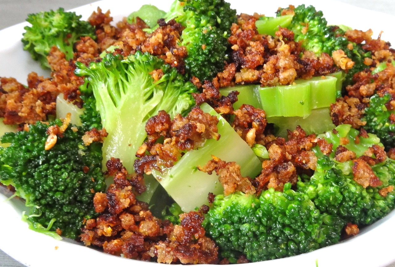 I've been in a broccoli sort of mood lately. Maybe it's because I read that broccoli stalks are healthy. So many people I know throw away the stalks. I actually think they are the best part. You have to peel them though, as I mentioned the other day (with instructions on how to do it).  Besides, it's a big waste to trash the stalks, isn't it? One of the things I learned at the China Institute when I took cooking lessons there decades ago, was how adept Chinese home cooks are using parts of products that other people throw away. Like broccoli stems. Try this recipe. The bread crumbs give the dish a nice toasty taste and crispy feel. Broccoli with Lemony Bread Crumbs  2 stalks broccoli 2/3 cup fresh bread crumbs (any kind) 1 tablespoon Dijon mustard 2 teaspoons grated fresh lemon peel 4 tablespoons olive oil 2 large cloves garlic, cut into thick slices salt and freshly ground black pepper to taste Remove about one inch from the bottom stems of the broccoli stalks. Peel the stems and cut the stems and florets into bite-sized pieces. Cook the broccoli in lightly salted simmering water for about 4 minutes or until barely tender. Drain under cold water and set aside. Mix the bread crumbs, mustard and lemon peel and set aside in a small bowl. Heat 3 tablespoons of the olive oil in a wok, stir-fry pan or deep sauté pan over moderate heat. Add the garlic and cook for a minute or so until the garlic begins to brown. Discard the garlic. Add the bread crumb mixture to the pan and sprinkle with salt and pepper. Cook, stirring constantly, and breaking up the mixture into crumbs, for 2-3 minutes or until the pieces are toasty brown. Dish out and set aside. Pour the remaining tablespoon olive oil into the pan. Add the broccoli and cook, stirring occasionally, for 1-2 minutes to reheat. Dish out into a serving bowl, sprinkle with the crumb mixture and serve. Makes 4 servings