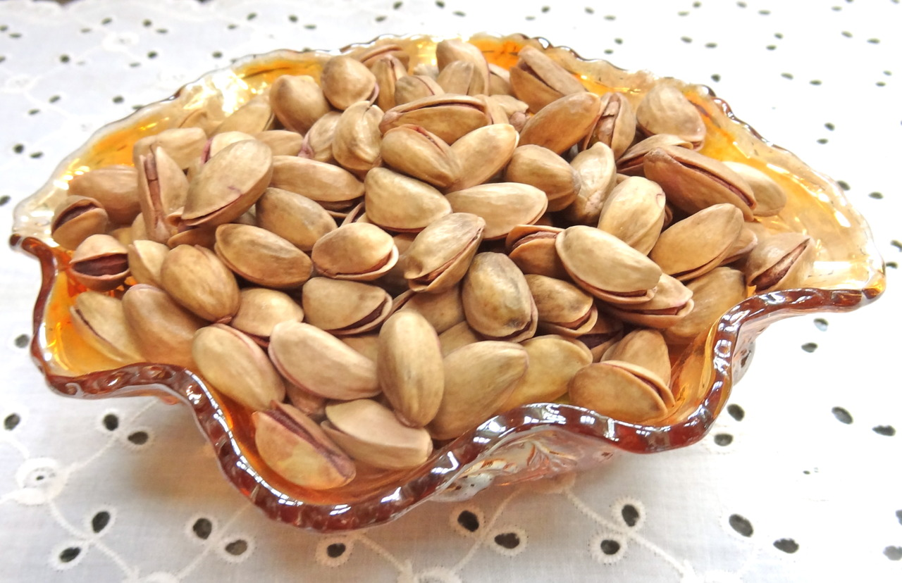 "Again. One more article on the pros and cons of pistachio nuts. This one about a study to determine whether eating pistachios can help you lose weight. The conclusion — in this study, anyway — is that these nuts do not figure much into your weight. BUT, they are healthy in that they contain the so-called ""good"" fats, lots of potassium and vitamins E and B6 and have a beneficial impact on your immune system as well as glucose and triglyceride levels. One of the facts the article pointed out was that pistachios in the shell act as a sort of hindrance to over-eating because it takes so long to open each one and that supposedly cuts down on the amount you eat. These people haven't seen me cracking open pistachio nuts. I am the world's expert I think, if only because I have loved pistachios for as long as I can remember, even from my kid days when they were dyed red and my hands always looked as if I had just finished a finger painting. I am the Superman of pistachio nuts. Faster than a speeding bullet.  I cook with these nuts too. They are so so good on top of fish and lamb. You know those recipes that call for bread crumbs? I often substitute crushed pistachio nuts and that has worked out just fine. Like here: use this mixture to press onto rack of lamb (this amount will cover 2); or some lamb chops for broiling or onto salmon for roasting or onto tomato halves for roasting. Pistachio ""Persillade"" 3 tablespoons Dijon mustard 1/2 cup finely chopped pistachio nuts 1/4 cup plain fresh breadcrumbs 1/4 cup olive oil 2 tablespoons chopped parsley 1/2 teaspoon grated fresh lemon peel 1 tablespoon chopped shallot, optional 1 teaspoon chopped fresh rosemary or 1 teaspoon thyme leaves Combine the Dijon mustard, pistachio nuts, breadcrumbs, olive oil, parsley, lemon peel, shallot and rosemary or thyme. Mix thoroughly and press onto food before roasting or broiling. Makes about 3/4 cup"
