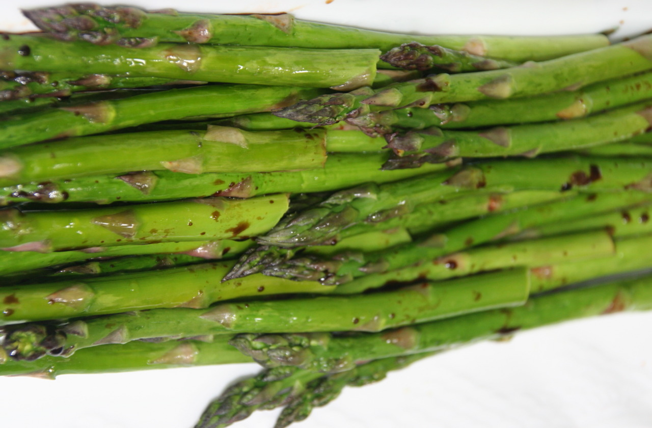 Need  quickie vegetable for Thanksgiving? Try roasted asparagus. It's among the easiest of side dishes you can make. It looks good. Tastes good. You can make it in advance. Serve at room temperature.  This is one of my go-to fall back dishes whenever I am stuck for an easy, veggie side dish, no matter what the occasion. Roasted Asparagus 1 pound asparagus 1/2 tablespoon olive oil salt and freshly ground black pepper to taste Balsamic vinegar Preheat the oven to 450 degrees. Wash the asparagus and remove the woody portions at the bottom. Peel if very thick. Coat the asparagus with the olive oil. Place the asparagus on a cookie sheet. Sprinkle with salt and pepper. Roast for 6-10 minutes, depending on thickness, or until barely tender. Let cool to room temperature. Sprinkle with Balsamic vinegar. Let rest for 15 minutes before serving. Makes 6 servings You can serve this hot too: sprinkle the just-roasted asparagus with a squirt or two of lemon juice. You can serve this topped with thin shavings of Parmesan cheese.