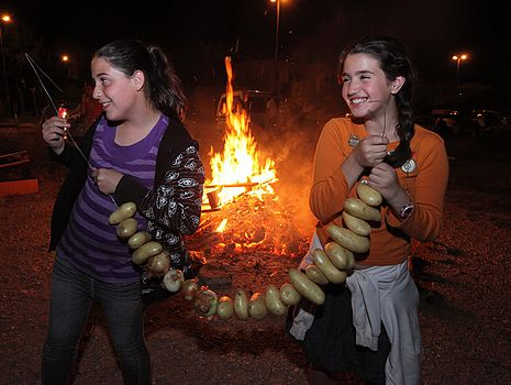 "There's an old joke that Jewish holidays all come down to this: ""They tried to kill us. We won. Let's eat.""  And so what can we say about today, which is a minor holiday called Lag B'omer. We aren't exactly sure what it is we celebrate, though it is a joyous day. It may have something to do with a victory against the ancient Romans, but it may have to do with a respite from a 2nd century plague.  Nevertheless, the third part of the joke is certain. On Lag B'omer, we eat. The tradition in Israel is to light bonfires and roast onions and potatoes. The picture here is from the Jerusalem Post, showing kids in Israel, holding a whole bunch of potatoes for roasting in that big bonfire.  On the other hand, I know some people who take this opportunity to roast marshmallows with their grandchildren.  I would roast potatoes on my outdoor grill, if it would only stop raining for a day. I like when russet potatoes get all black and crusty on the grids. It reminds me of my grandmother's old potato roaster. The potatoes were always crunchy crusted and tasted oh so fabulous all slathered with butter and sprinkled with salt. Who needs chocolate when you have a treat like that!?  But, it's probably going to rain again. Tell that to the climate-change deniers.  So, toasted marshmallows, made inside, sound good to me. Especially on top of ice cream for a tasty sundae.   Toasted Marshmallow Sundae   one scoop ice cream  4-5 ripe, sweet strawberries  4 marshmallows  1-2 tablespoons chopped toasted almonds     Place the ice cream in a bowl. Mash the berries and spoon them on top of the ice cream. Roast the marshmallows (I use a metal skewer and line them up) until they are black on the outside and oozing inside. Spoon them over the berries. Sprinkle with the nuts.  Makes one"