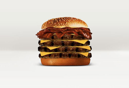 "sprinklefingers :      wcfoodies :      deleteyourself :     Burger King now has a  quad-stacked hamburger .  With a large coke and fries that comes out to a whopping 1840 calories. Don't forget to add some ""Funnel Cake Sticks"" for dessert.     Every time you eat, you're voting for a food system. The less shit like this we consume, the less likely we are to see unnecessary, unhealthy abominations like this on the international menu. This is disrespectful all the way up the chain, from the animals slaughtered for this base gluttony to the farmers out there who put care into their meats and produce to the consumer, both those of us who'd never touch this sandwich to those who would. It doesn't matter if you wouldn't eat this; other Americans will, and we'll both pay the price, they with their health and we with our tax dollars to support rising medical costs for a nation poisoning itself.   How do you stop it? Don't eat this sandwich. Don't eat from fast food restaurants, period. Vote with your dollars by shopping at the farmer's market. Vote with your stomach by eating real food, grown on real farms. Don't give in to convenience and excess just because you can.     Amen to that, sister.     I'd like to sneak a peak to see who actually orders this monstrosity. It is positively suicidal. Or is it homicidal? Do these guys have some secret plan with the drug companies who manufacture diabetes medication?"