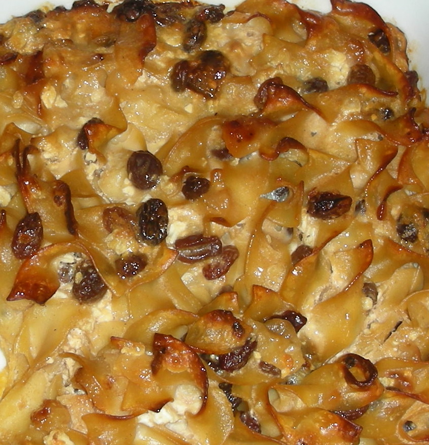 "KUGEL CHALLENGE II Just because Rosh Hashanah is over doesn't mean I'm no longer thinking about kugel. Good food memories linger and besides, I always serve kugel for my Yom Kippur break-the-fast — the Linda/Susan recipe I mentioned last week — so I still have noodle pudding on the brain. I know that ultra-rich and crunchy topped version is coming next Saturday night, so in the meantime, in between holidays, I like to tinker with different recipes. My mother was an ""if a recipe works why fix it?"" person. But I can't help myself. I experiment a lot to see what happens if you add this or that. Not necessarily to make it better. Just different. I came up with this one, Cranberry-Orange, a traditional kugel with a contemporary twist. It's sweet, tender in the middle and crunchy on top.  Cranberry-Orange Noodle Kugel 1 cup dried cranberries 1/4 cup orange juice 1 pound wide egg noodles 1/4 pound butter, melted 6 large eggs 2 cups cottage cheese 1-1/2 cups dairy sour cream 1/3 cup sugar 1 teaspoon ground cinnamon 2 teaspoons grated fresh orange rind 1/8 teaspoon salt Place the cranberries in a bowl and pour the orange juice over them. Let soak for at least 30 minutes. Set aside. Preheat the oven to 350 degrees. Butter a 9""x13"" baking dish. Cook the noodles al dente (not quite done). Drain the noodles and place them in a large bowl. Pour in the melted butter and stir to coat all the noodles with the butter. In a separate bowl, combine the eggs, cottage cheese, sour cream, sugar, cinnamon, orange rind and salt. Mix thoroughly. Spoon the cheese mixture over the noodles and toss to coat all the noodles. Add the cranberries and any remaining juice. Mix in. Place the mixture into the prepared baking dish. Bake for about 40 minutes or until the top is browned and crunchy. Makes 8-10 servings Ask Ronnie a question: http://ronniefein.com/ask To comment: http://ronniefein.com/submit"
