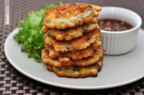 foodforjubilee :      Spicy Corn Fritters | droolfactor      Photo of a stack of crispy corn fritters greeted me as I went to Tumblr this morning. I haven't eaten corn fritters in years and this brought back some delicious memories. My mother used to make corn fritters all the time and serve them with fried chicken. (She made the best fried chicken.)   Her recipe isn't as sophisticated as this one, which has cumin and coriander and a spicy dipping sauce.   Her fritters were a more old fashioned Southern style and she served them with maple syrup. They were memorable, so I'm posting the recipe. Easy to cook and the are really terrific with any meat or vegetable you grill over the summer.   Corn Fritters   1 cup flour   1 teaspoon baking powder   1/2 teaspoon salt   1/2 teaspoon sugar   1 large egg   1/2 cup milk   2 tablespoon melted butter   1 cup corn kernels (fresh or thawed frozen)   vegetable oil for frying   maple syrup   Sift the flour, baking powder, salt and sugar into a bowl. In a second bowl, beat the egg, milk and melted butter together. Add the liquids to the flour mixture. Fold in the corn kernels. Heat enough vegetable oil in a large saute pan to come 1/4-inch up the side. Cook over medium-high heat until hot enough to make a bread crumb sizzle. Drop the corn batter by heaping tablespoonful onto the batter, leaving at least 1/2-inch space between fritters. Fry for about 2 minutes per side or until golden brown and crispy. Drain on paper towels and serve with maple syrup. Makes 6 servings   Ask Ronnie a question:  http://ronniefein.com/ask    To comment:  http://ronniefein.com/submit