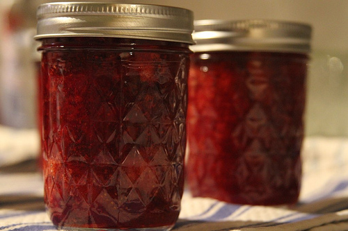 twohungrydudes: 365 Days of Food #157 Strawberry Jam (by JoeFoodie) Using our fresh picked strawberries, we made jam this evening.  A fun, if labor intensive, process.  The jam is delicious - lots of strawberry chunks, super sweet with a slightly sour finish.   We had a strawberry patch in our backyard when I was a kid. If there was a big harvest my mother would cook up some strawberry jam and the house would smell like the cotton candy concession at an amusement park. Then there came the time when someone knocked over the filled Mason jars. It was proibably my brother, nicknamed Moose for obvious reasons. My mother had just filled those jars and hadn't yet sealed the tops. All the thick red liquid spilled onto the kitchen floor like molten sugar lava. It was a complete disaster. Strawberry season was over and my mother, who had worked so long and hard, never made strawberry jam again. I am so happy to read that someone is doing it. BRAVO! If you do it again, try adding peppercorns to some. DELISH!!