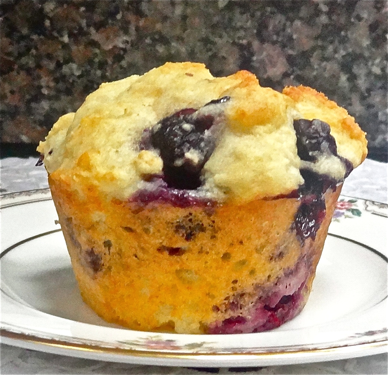 A few days ago I posted a recipe for gluten free blueberry muffins made with almond flour and oat bran. But a gluten free diet is not for everyone, so if you're like me and can't resist the tons of blueberries available now and buy them by the six-pack as I do, and you also love blueberry muffins in the summer when the berries are so fat and sweet, here's a really simple recipe for traditional blueberry muffins. These are plain, vanilla-y flavored. You can add a teaspoon of grated fresh lemon peel or orange peel for a more citrusy taste. You can also add a half cupful of chopped nuts. Blueberry Yogurt Muffins 4 tablespoons unsalted butter 1-3/4 cups all-purpose flour 1/4 cup sugar 1-1/2 teaspoons baking powder 3/4 teaspoon salt 1/2 teaspoon baking soda 1 cup plain yogurt 1 large egg 1 teaspoon vanilla extract 1 cup blueberries Preheat the oven to 400 degrees. Lightly grease 10 muffin cups. Melt the butter and set it aside. Mix the flour, sugar, baking powder, salt and baking soda together in a bowl. In a second bowl, combine the yogurt, egg and vanilla extract and blend them thoroughly. Pour the liquid ingredients into the flour mixture and stir just to bend ingredients. Fold in the blueberries. Drop into the muffin cups. Bake for 20-25 minutes or until a cake tester inserted into the center comes out clean. Makes 10