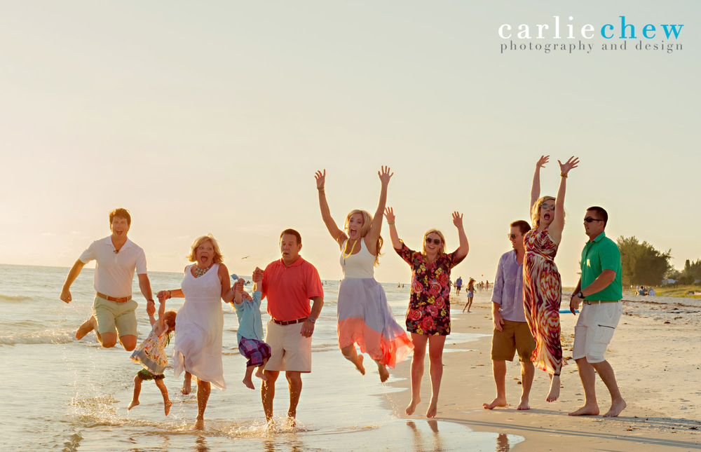 Family jumping at beach for portrait photography on Anna Maria Island, Florida by Carlie Chew