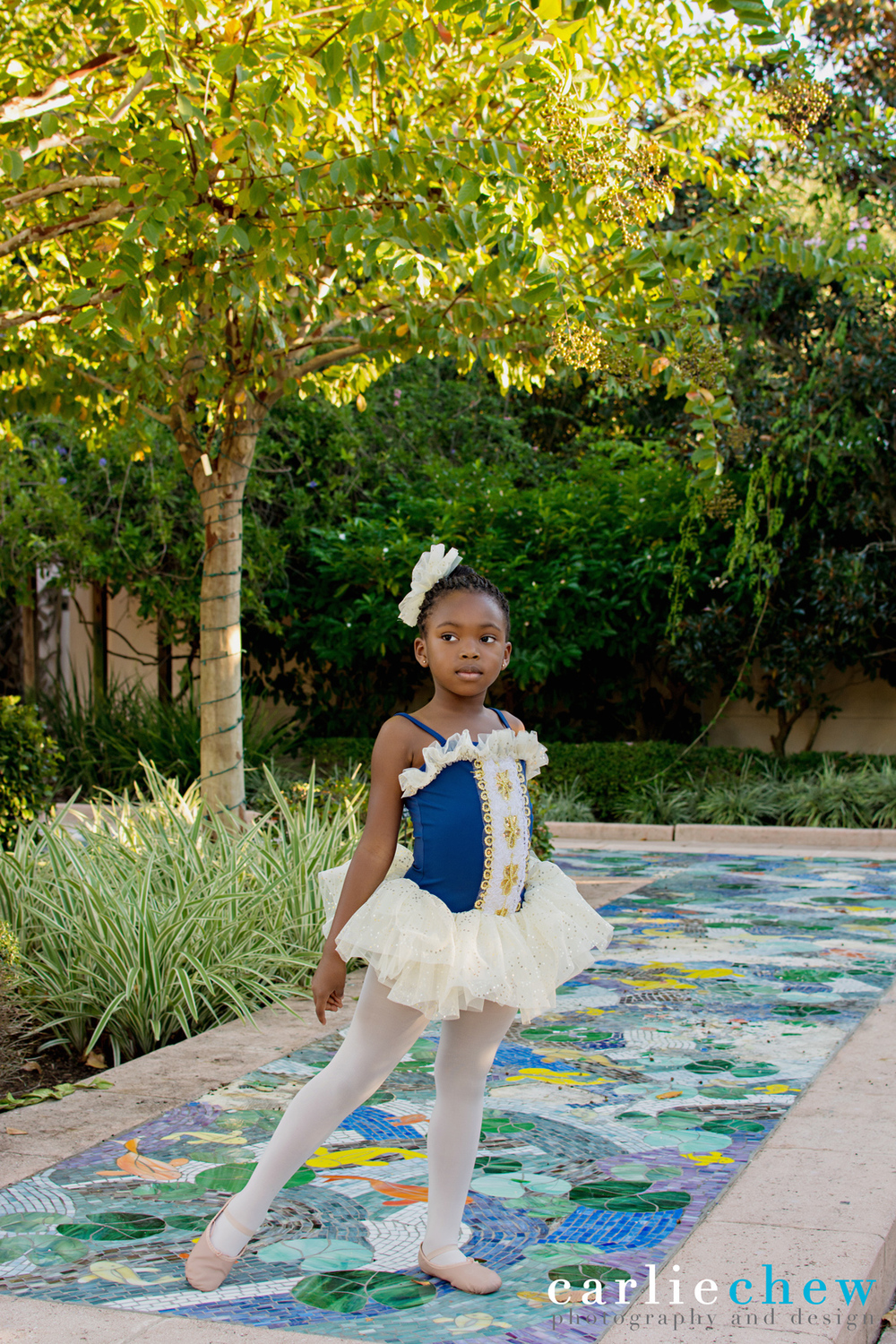 Child ballerina poses for Carlie Chew Photography at The Florida Botanical Gardens