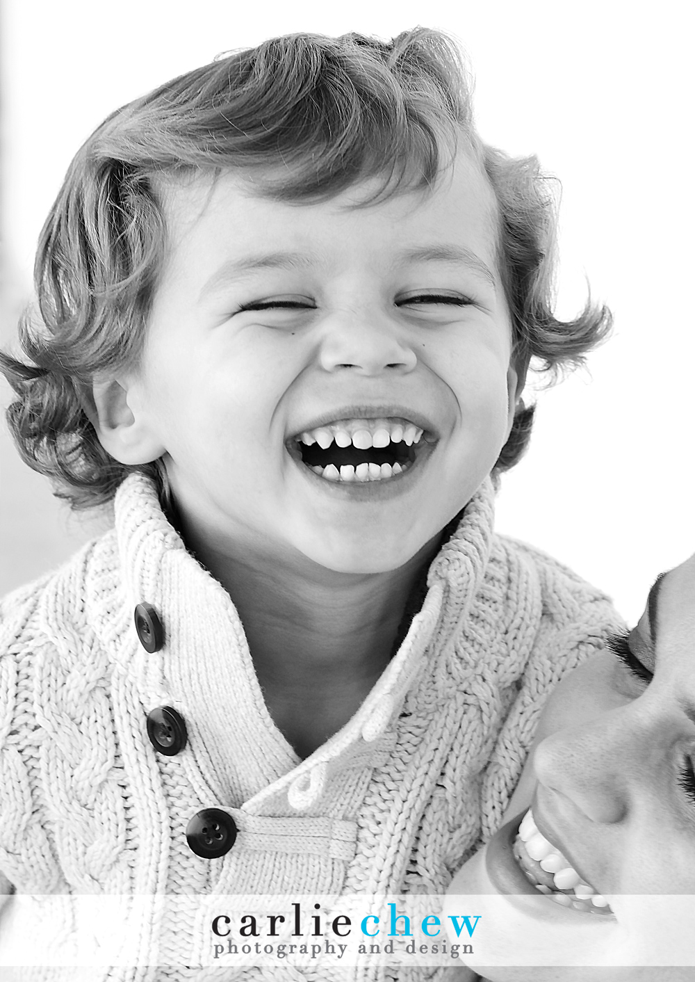 Child laughing in mother's arms photographed by Carlie Chew Photography of St. Petersburg, Florida