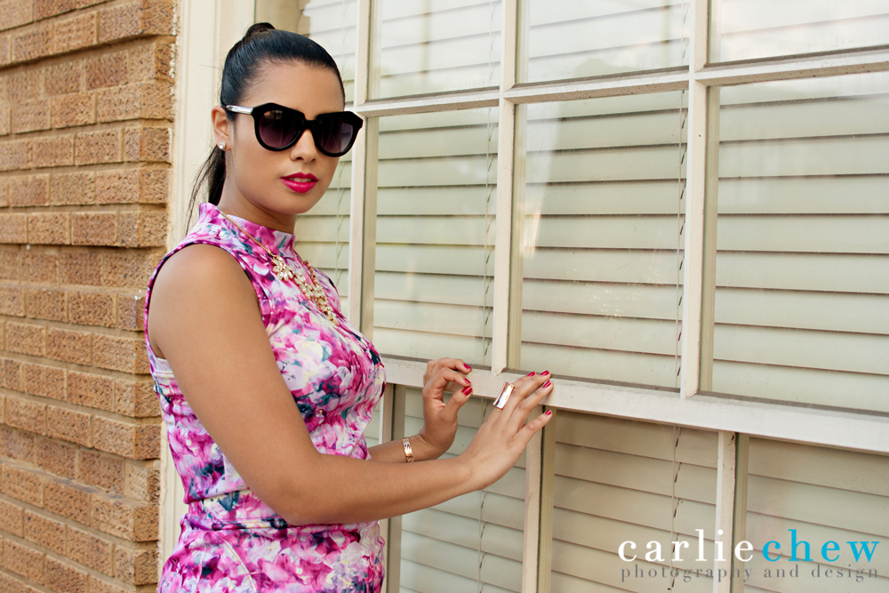 Girl in sunglasses poses for fashion photographer Carlie Chew in Ybor City of Tampa, florida