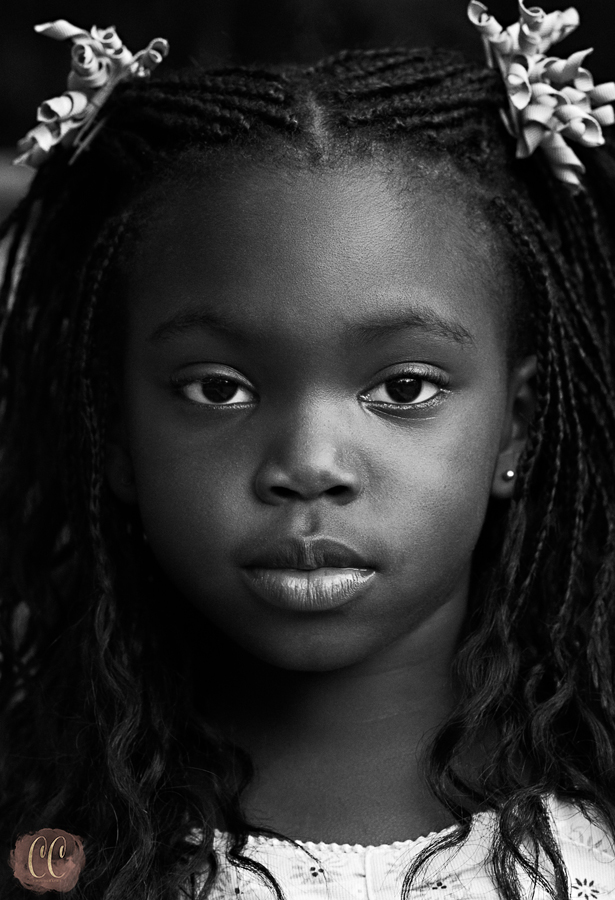 Black and white portrait of a child portrays innocence in Tampa Florida with Child photographer Carlie Chew Photography