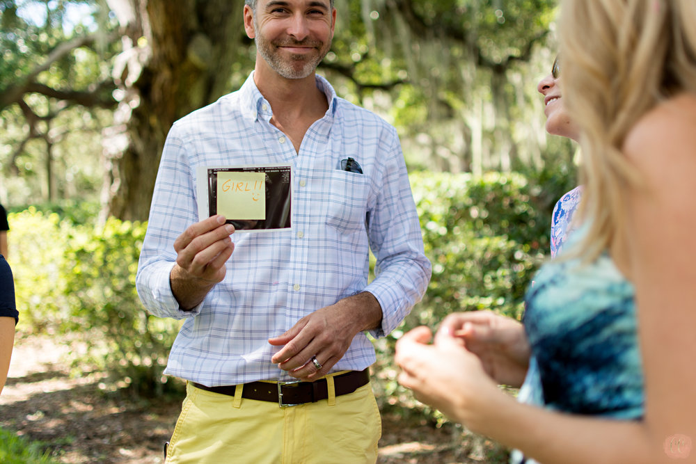 Dad finds out his baby is a girl at a gender reveal party at The Tampa Yacht club shot by Tampa family photographer Carlie Chew Photography
