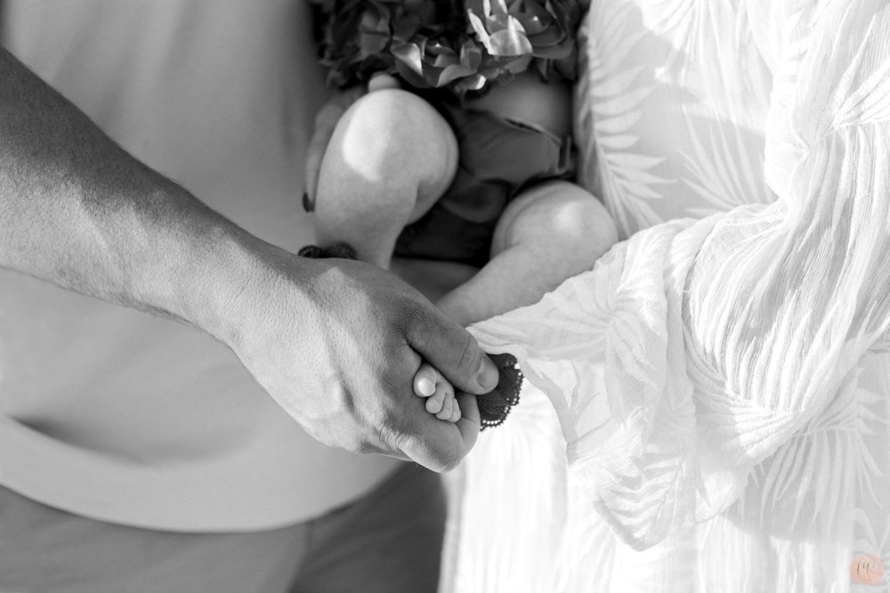 Black and white photo of newborn baby feet for family photographer Carlie Chew Photography at Honeymoon Island in Dunedin, Florida