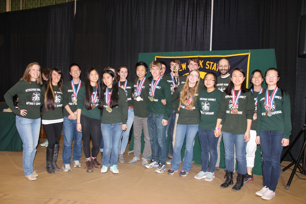 Left:  Mrs. Perry (coach), Mrs. Mason (coach), Ray Gu, Karen Zhan, Shirley Zhang, Meredith Levy, Lucy Langenberg, Luke Qi, Nick Corso, Matthew Hasenwinkel, Ryan McHugh, William Shepardson (captain), Sarah Percoski, Urie Choi, Mr. Buchman (head coach), Kristina Liu, Maddy Lee, Mimi Lu