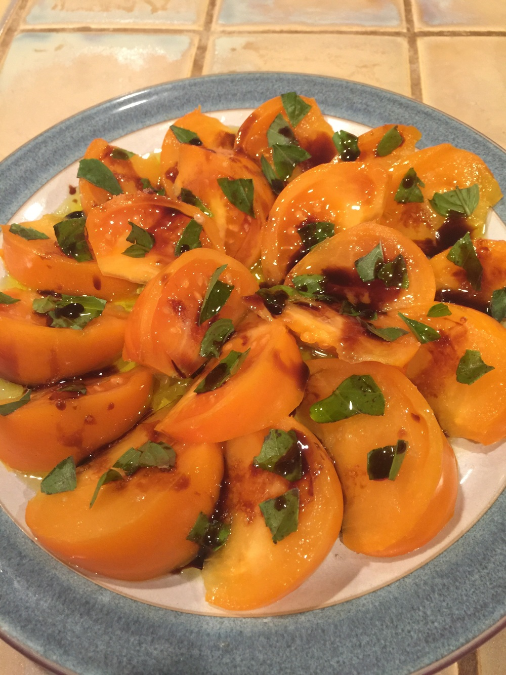 Sweet yellow tomatoes with basil, sea salt, olive oil and balsamic vinegar