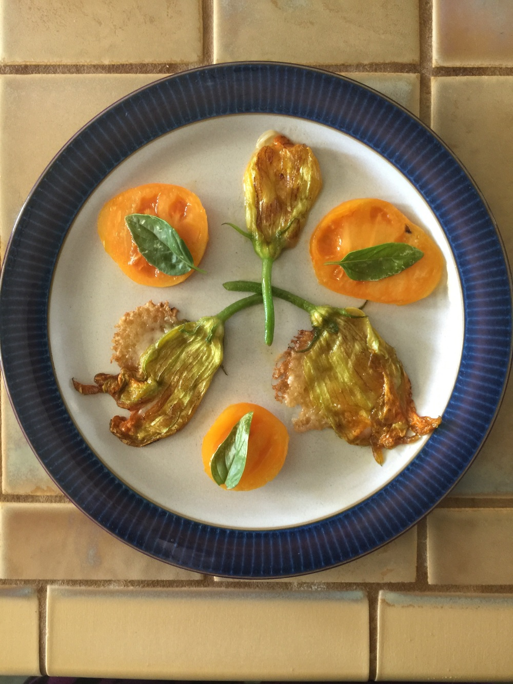 Squash blossoms stuffed with Gruyere cheese and sautéed in olive oil