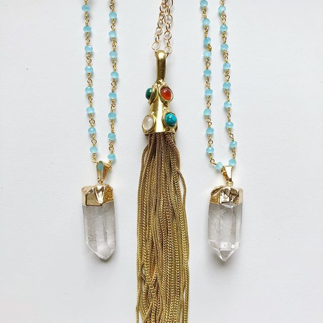 "Time for long, statement necklaces! I have two blue beaded necklaces with a quartz drop. They are 36"" long with a 1.5"" drop. $30 each. The gold tassel necklace is on 14k gold filled chain and 36"" long with a 5"" drop. $30. To buy, post ""sold"" and if blue beaded or gold tassel. $3 flat shipping fee added to all orders."