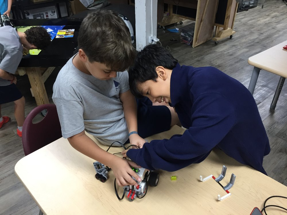 WORKING on their Robotics 1 badge.
