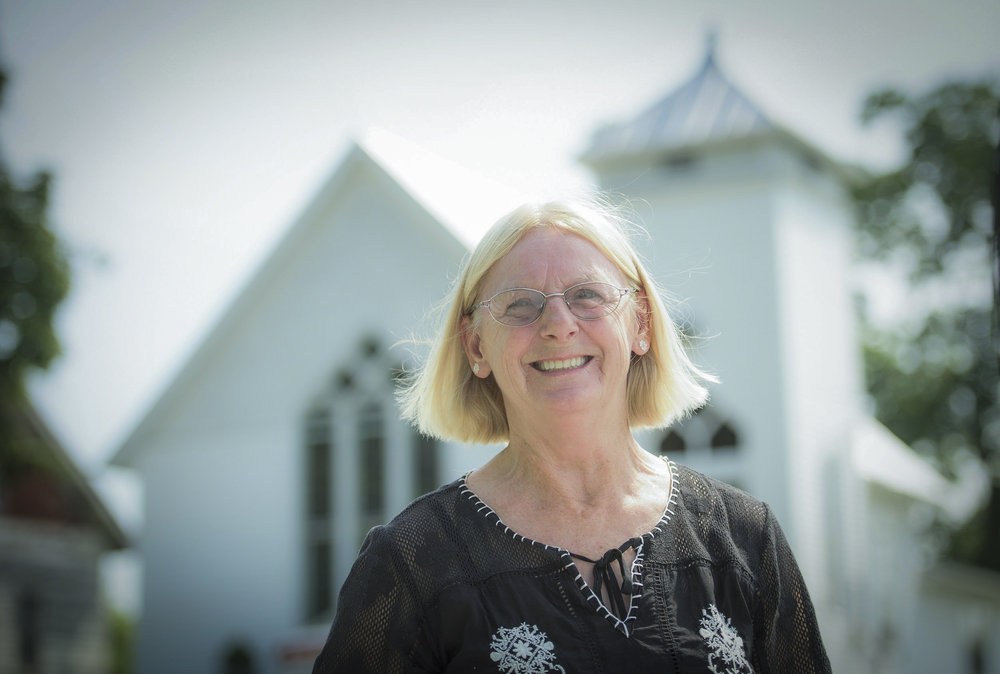 Mary Withers, a life-long resident of Boyd, Kentucky in front of the historic Boyd Methodist Church. (Photo by Jack Gruber)