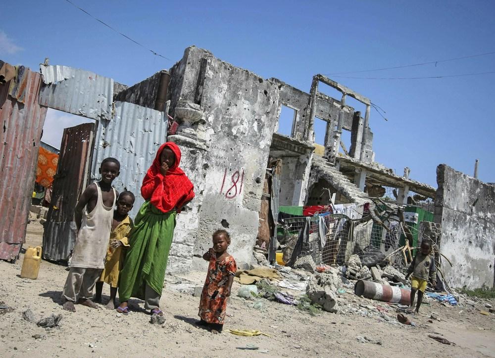 children admist war fallen bricks and hope.jpg