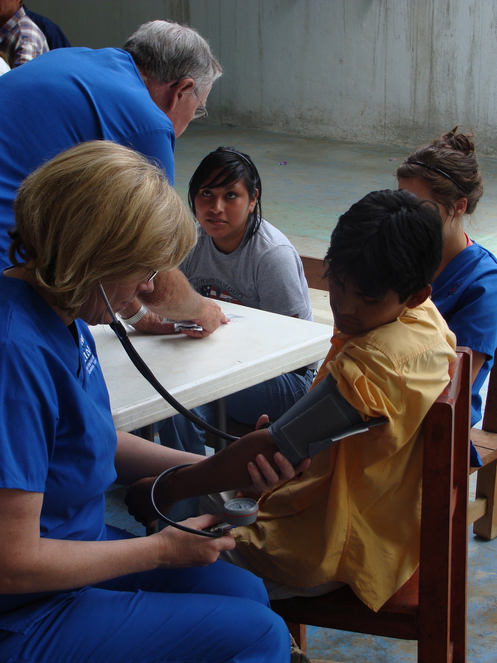 Volunteers providing healthcare check ups