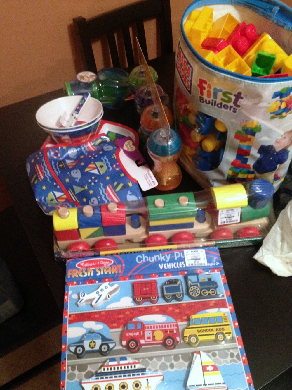 Kid purchases: puzzle, train, blocks, bib, bowls, plates, spoons, and sippy cups.