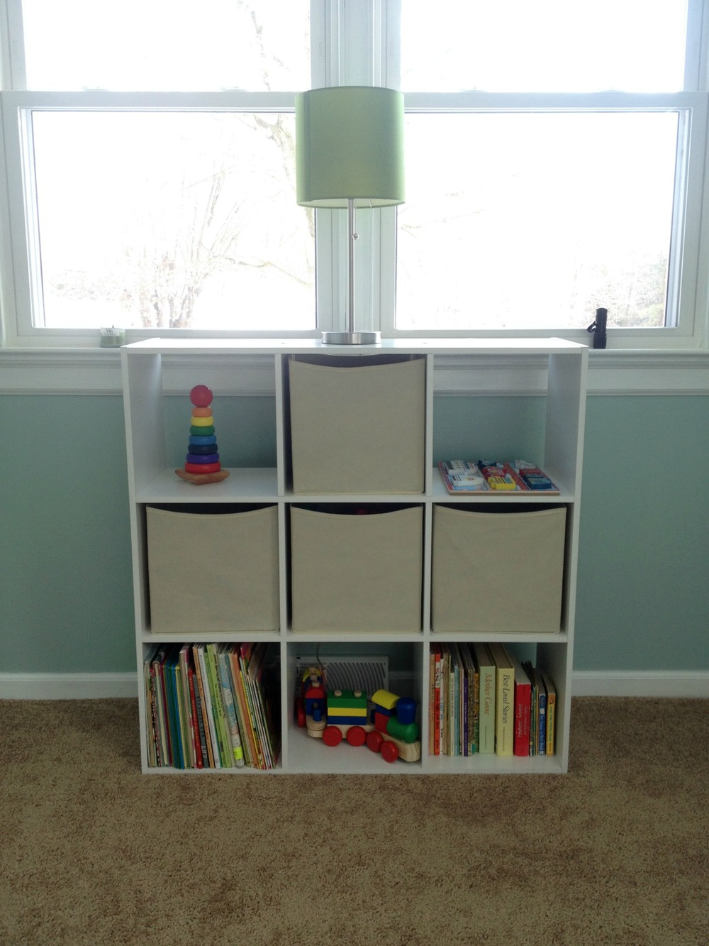 This cube organizer will act as a dual nightstand, toy box, bookshelf.