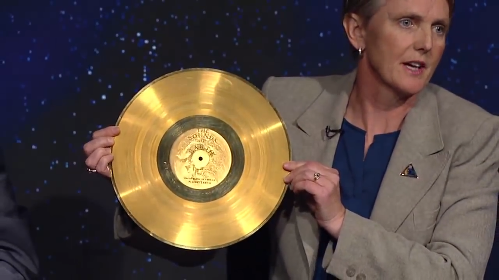 Voyager Project Manager Suzanne Dodd holds a copy of the Golden Record.  Photo Credit: NASA
