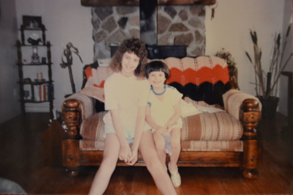 That would be my sister on the left with the poodle on her head. I am on the right and there is actually a pony tail hanging off that hair bowl that's on my head.