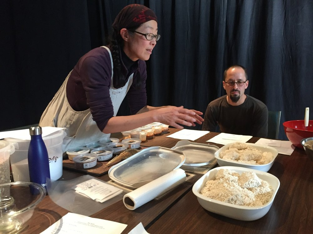 Mariko Grady (left) explains how koji is developed. Shinichi Iova-Koga (right) looks on. Photo by Kyoko Yoshida.   Click to download
