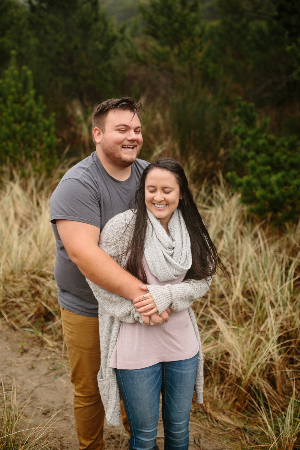 A young couple laughing during their photo shoot