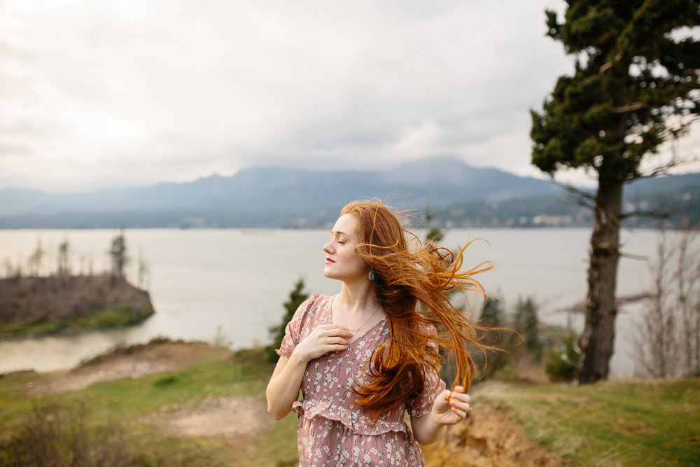 A Woman Letting the Wind Blow Hair From Her Face and Through Her