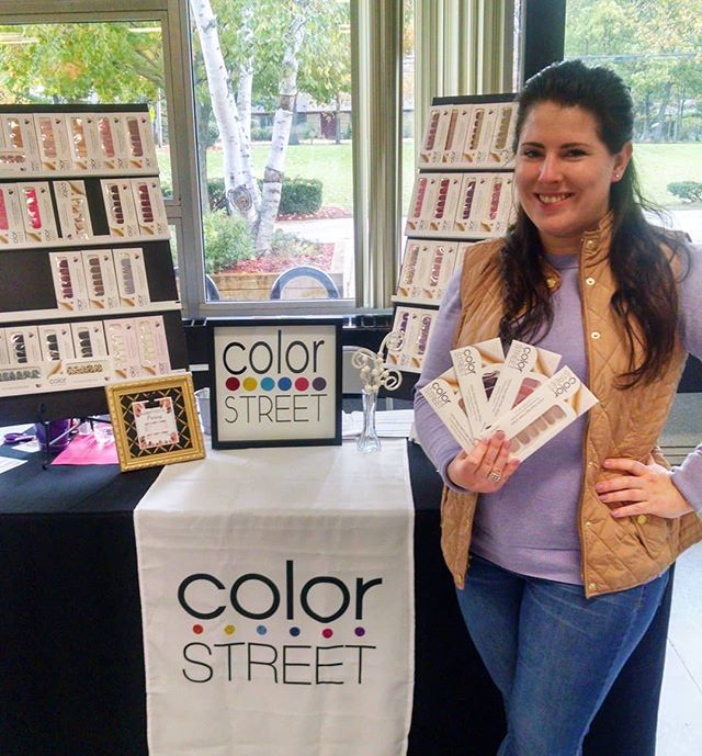 I'm at Forsythe Middle School for their annual holiday vendor showcase. If you want to buy some nail polish in person and take it home with you today, right now is the time! I'm wearing and holding up color street's new solids! #colorstreetnails #holidayshopping