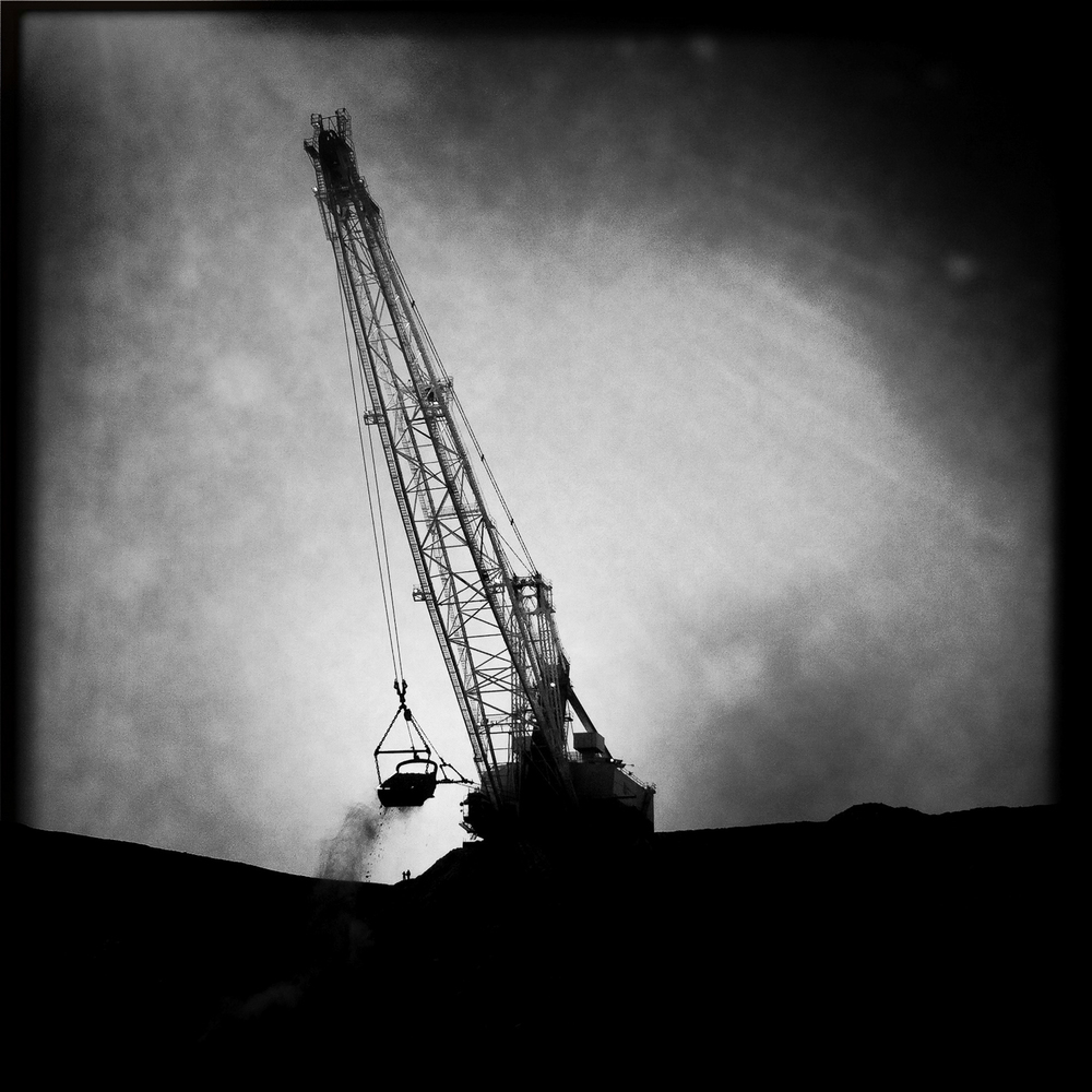 Engineers stand aside a dragline in action. Qld, 2012.