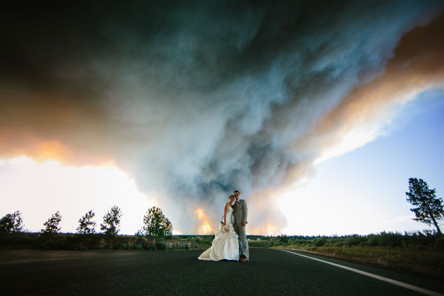 A wildfire in Oregonbrought the fire brigade to the wedding reception. Photography Credit:Josh Newton