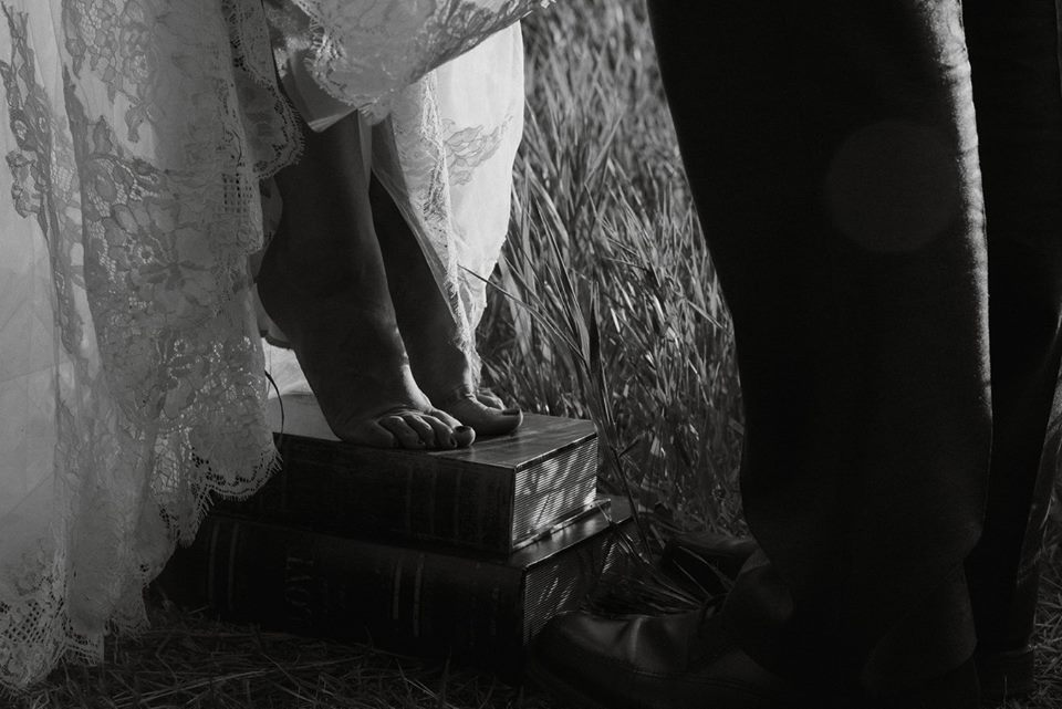 Bride standing on books