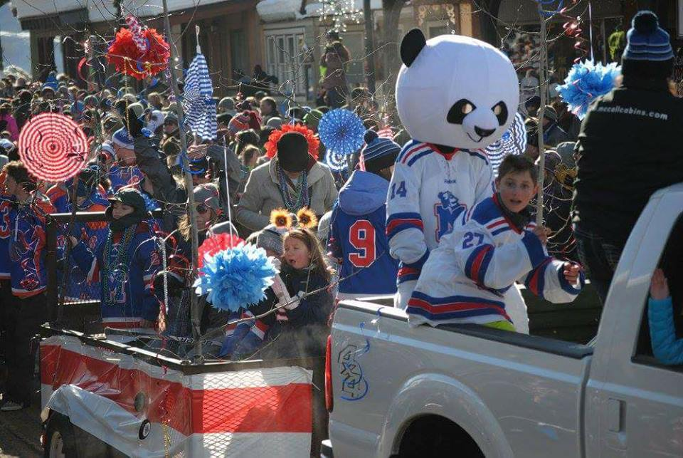 Winter Carnival parade with the McCall Squirts and William the panda.