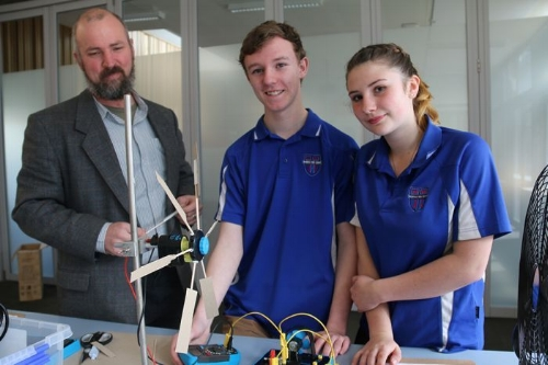 Students Toby Thorpe and Zephryn Fox with Huonville High School Principal Geoff Williamson and the STELR Renewable Energy resources.  Photo credit: ABC News, Rhiannon Shine