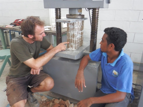 Hamish Training staff in Timor-Leste in materials research and house construction