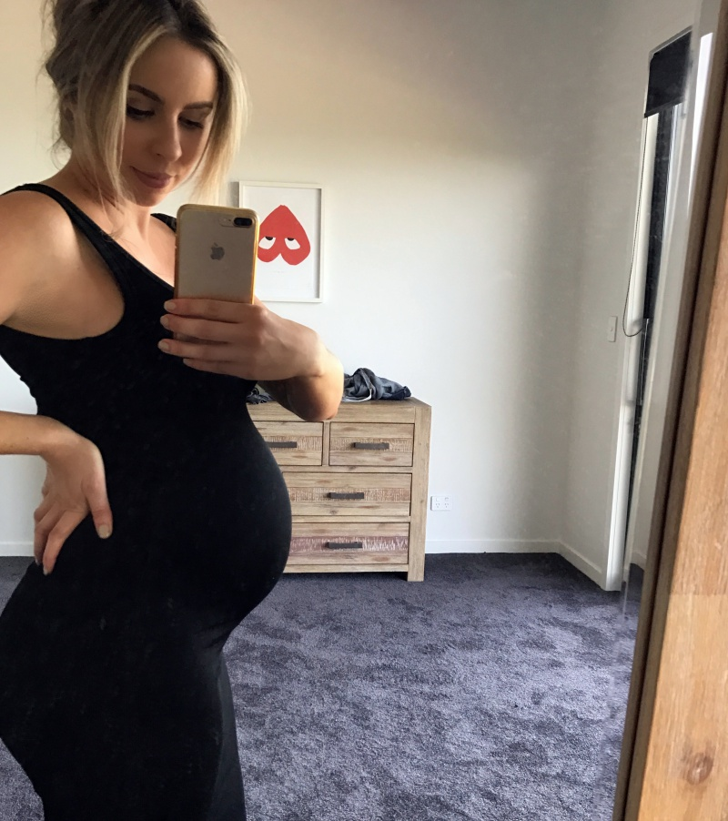 8 months pregnant in my favourite stretchy dress - one of the only things that fit at this point!