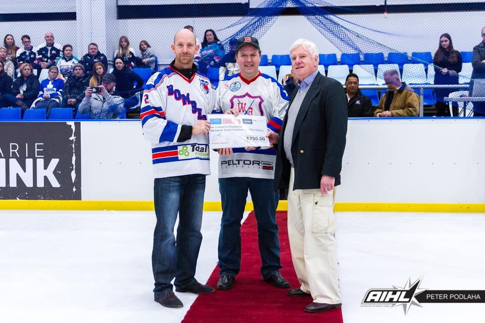 Mark Gibson from COVERED. and Dr Frank Gregg from Macquarie Ice Rink presenting a donation cheque to Corey Clark (younger brother of Matt Clark)