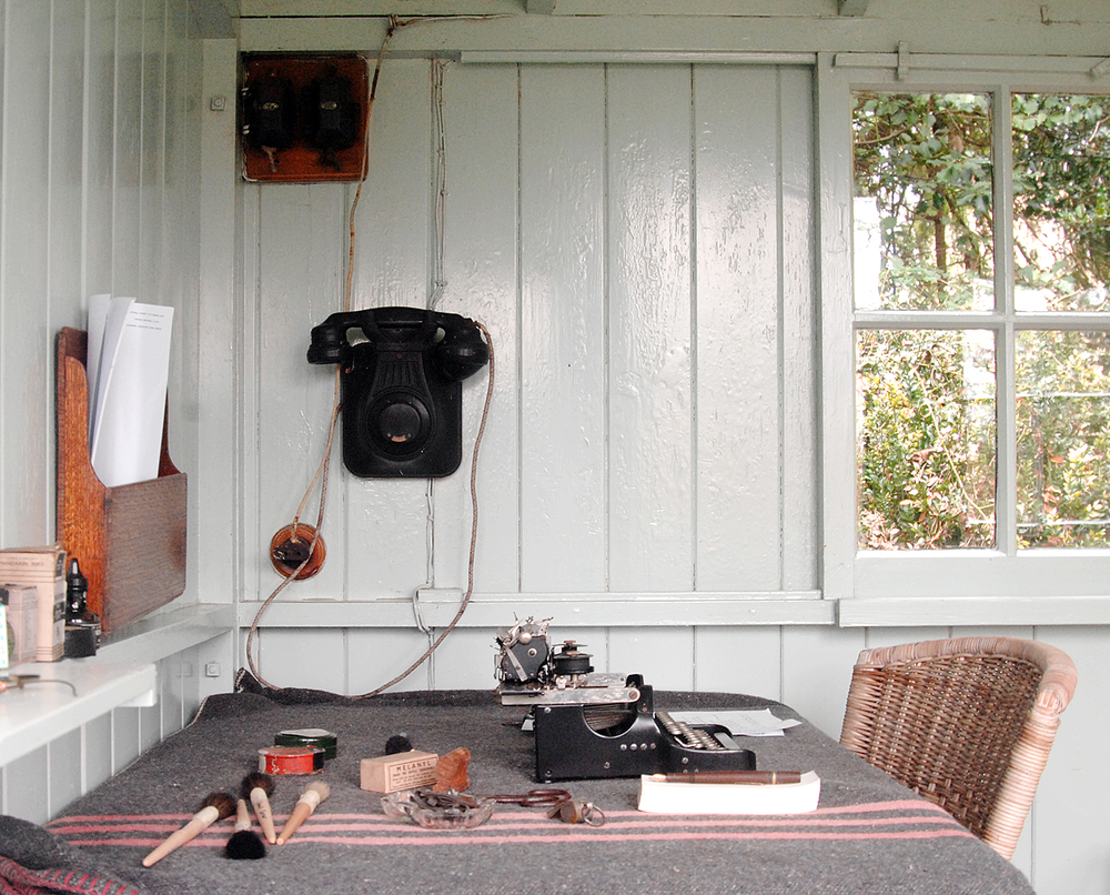 Interior of George Bernard Shaw's rotating writing shed at Shaw's Corner. He used the telephone to contact his wife in the main house.