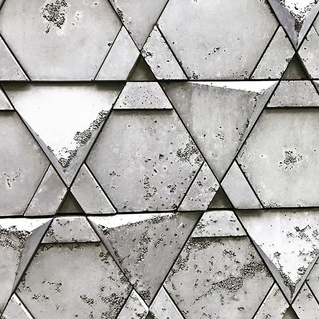 Texture in the city. Cast concrete tile wall #interiordesign #provostonthego #provoststudio #architecture