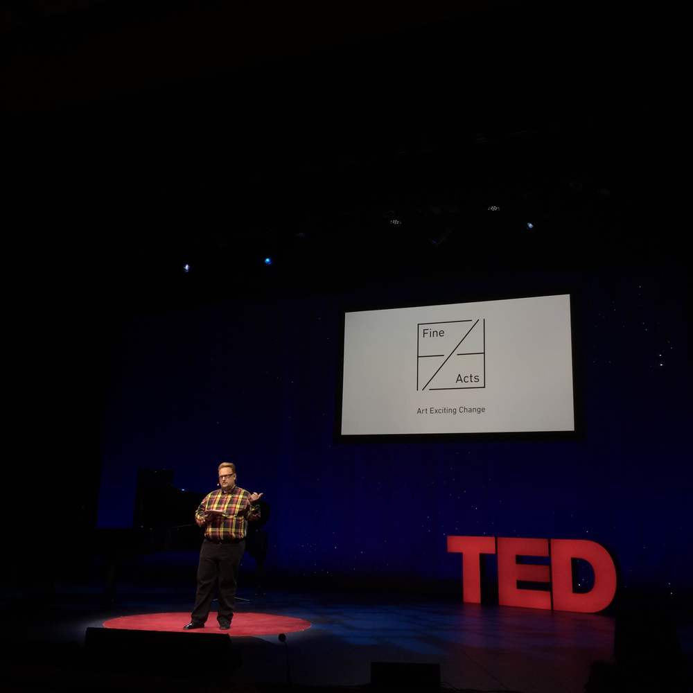 Tom Rielly, TED Fellows Director, talks about the initiative on stage.