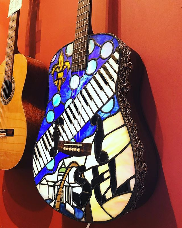 Check out this stained glass guitar!  An irreparable dreadnaught came into the shop and a local artist turned it into a beautiful piece of art. It also features a light inside that is plugged in so you can really see the stained glass.