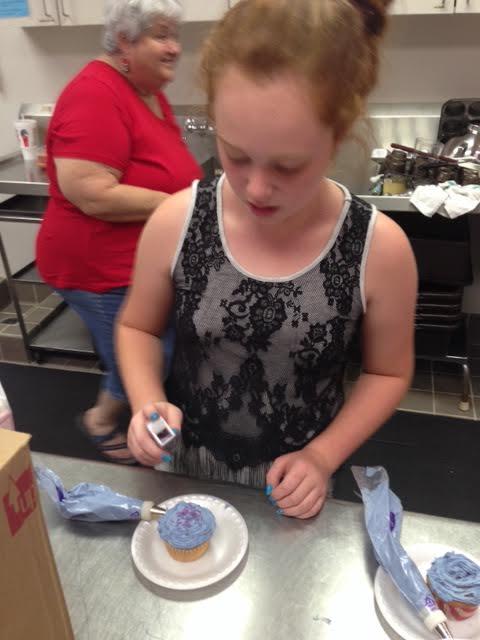 sprinkling the cupcake.jpg